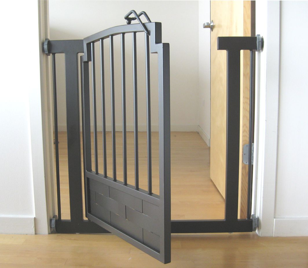 Pressure mounted dog gate showing weave pattern sheet metal